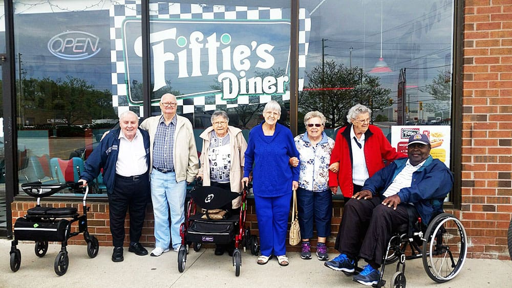 """Some Cardinal Retirement residents outside a restaurant called the """"Fifties's Diner"""""""