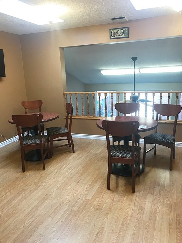Tables and chairs in the snack area of the Cardinal Retirement Residence.