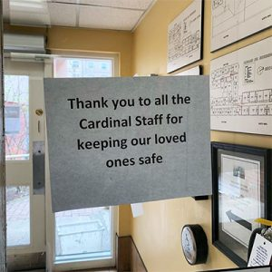 """Sign outside the office. It says """"Thank you to all the Cardinal Staff for keeping our loved ones safe."""""""